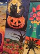black cat in pumpkin