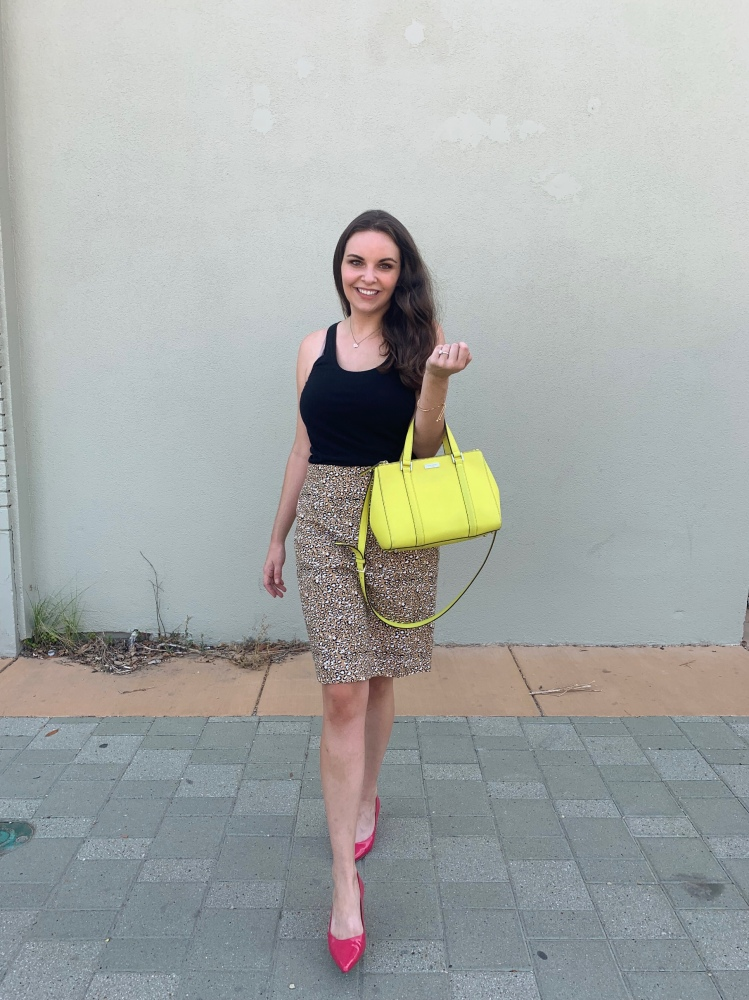 leopard print skirt and bright bag